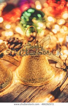 Find Christmas Jingle Golden Bell Decorations Rusty stock images in HD and millions of other royalty-free stock photos, illustrations and vectors in the Shutterstock collection. Thousands of new, high-quality pictures added every day. Christmas Jingles, Christmas Ad, Gold Light, Wood Background, Decorative Bells, Photo Editing, Royalty Free Stock Photos, Bulb, Pictures