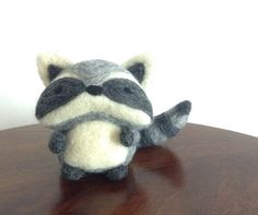 ~Made to Order~  This cute, chubby little needle felted raccoon is handmade with love out of 100% natural wool. This wise woodland friend would