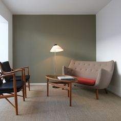 Eye Table was designed in 1946 for the sofa 4600.The eye-shaped sofa table 4850. / House of Finn Juhl + One Collection [www.finnjuhl.com]