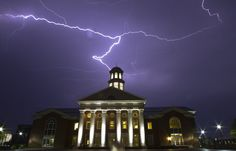 Lightning fills the sky over the Trible Library on the campus of Christopher Newport University Saturday evening as another night of threatening storms pass over the Peninsula. (Adrin Snider / July 1, 2012)