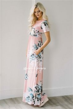 This is one of the most beautiful maxi dresses we have seen! Our Pretty as a Petal Maxi dress is a beautiful light pink and features short sleeves, an elastic waist, cute pockets and a lovely dusty blue and white floral print.