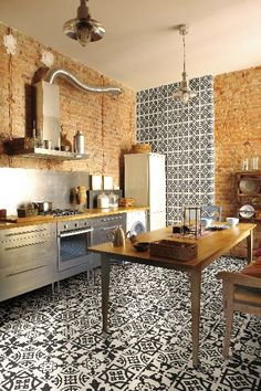 The Bulgary #tile series from Mainzu creates drama on both the floor and accent wall of this kitchen with coordinating patterns. #ceramic #TileofSpain