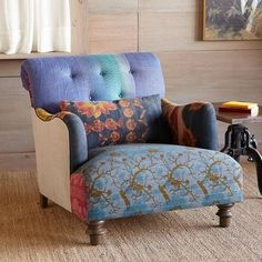 Upholstered with vintage Sari cloth.