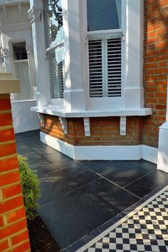clapham balham Victorian front garden mosaic tile path red brick wall black paving metal wrought iron gate and rail london terrace balcony Victorian Front Garden, Victorian Porch, Victorian Terrace House, Victorian Homes, Garden Paving, Garden Tiles, Terrace Garden, Planter Garden, Mosaic Garden