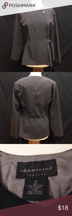 Connected Apparel Wrap Around Dress Jacket Bust 44 Waist 39.5 Length 26 Arm length from pit 18. Material stretches. It has shoulder pads. It is in excellent condition. Has no rips stains or tears has some light wear.  Unlike other dress  jackets that are made from a stiff material this one is made with a soft pliable material. Connected Apparel Jackets & Coats Blazers