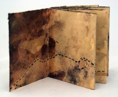 """artist : Trace Willans , Title :""""The Earth"""" by BookArtObject (collective project ) 9cm wide x 11cm tall. Accordion binding; watercolour paper, ink and wax. (via Flickr)"""