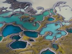 Volcanic lakes punctuate an Icelandic landscape seen from above in this National…