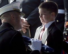 The 8-year Chriastian Golczynski accepted the flag gor his father Marc Golczynski during the commemoration . The Marc Golczynski  was killed in Iraq, a few days before returning home..