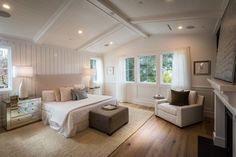 Traditional Master Bedroom with Cathedral ceiling, Wainscoting, Hardwood floors, Carpet, Box ceiling, metal fireplace
