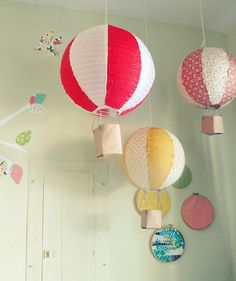 Great tutorial for hot air balloons {made using paper bags, paper lanterns, fabric, glue & string} - by Joye
