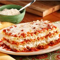 Lasagna ... added a lb. of ground beef to the sauce and used cottage cheese instead of ricotta cheese *~TM~*