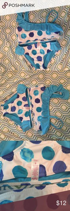 Justice girls swim suit. Size 8. VERY NEW Great condition very new justice girls swim suit. Size 8. 2 piece set. White with blue dots & ruffles. Very cute piece. Price firm. Justice Swim Bikinis
