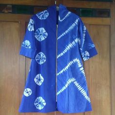 Shibori, stitch resist. Unfortunately, this was pinned without linking to source or website, so I have no idea who created this beautiful blouse.