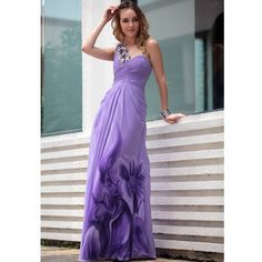 TARA IN PURPLE PLEATED PROM DRESS WITH FLORAL STRAPS Dashing soft purple prom dress featuring one shoulder A Line silhouette, high waist, floor length printed skirt with chiffon overlay, pleated bodice, and sparkling floral embellishments on neckline, strap and back. £234.00