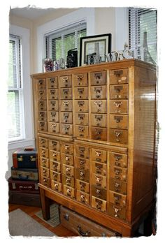 I so badly want a vintage library card catalog cabinet in my living room