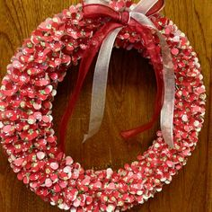 Cute Christmas wreath- use flower hole punch to punch scrapbook paper, using quilting pins push them into a styrofoam floral wreath, add a bow and wala!