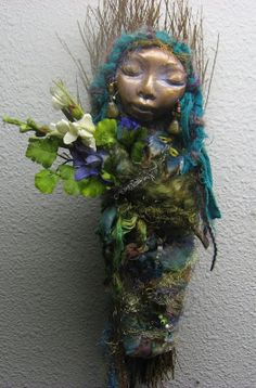 These spirit dolls combine polymer clay, fibers, beads and paper flowers. The Bohemian Art Spirit: Interpretation of Gaia, Earth Mother