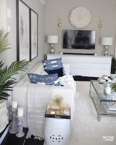Looking to decorate your living room for summer? I've got lots of amazing tips that anyone can do to get a designer look! Elegant living room decorating ideas. #cofeetable #stying #ideas #white #blue #elegant #livingroom #decorideas Elegant Living Room, Living Room Grey, Living Room Decor, Blue And White Pillows, Decorating Coffee Tables, Interior Design Inspiration, Decorating Tips, Living Room Designs, Room Ideas