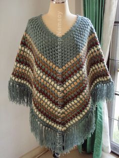 You were not a child of the unless you had a crocheted poncho! Momma crocheted me two one in pinkish white and another in darker blue My 2 younger sisters wore their ponchos five days a week!You were not a child of the unless you had a crocheted ponc Crochet Poncho Patterns, Crochet Scarves, Crochet Shawl, Crochet Clothes, Crochet Stitches, Knitting Patterns, Crochet Woman, Love Crochet, Knit Crochet