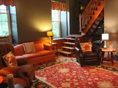 colorway: green, red wood floors, brown and red furniture, wood tan and cream accents.