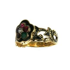 """An unusual 18K yellow gold early Victorian black enamel memorial ring featuring a cluster consisting of a ruby, emerald, garnet, amethyst, ruby and diamond to spell out the sentimental message """"regard"""". English, dated 1843."""