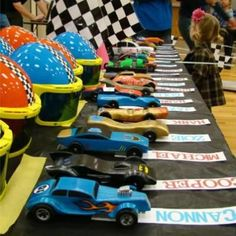 this is a link to a Pinewood Derby Birthday Party. i like the picture to remind us to have 'reserved' parking spots, with names, at the next real pinewood derby.