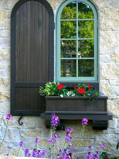 Love the rounded window, shutters and flower box