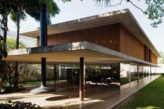 long-glass-house-with-folding-wooden-facade-4-patio-angle.jpg