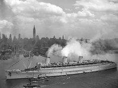The original Queen Mary sailing into New York harbour carrying wounded troops WW2