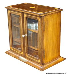 Edwardian Smokers Compendium Cabinet - Circa 1900 - Oak and Satinwood Inlay - Read more on The Website - Click here http://www.fennelly.net/Antiques/Newest%20Listings%20-%20Art%20and%20Antique%20Gallery%20Dublin/042%20Edwardian%20Smokers%20Compendium%20Cabinet%20-%20Circa%201900%20-%20Oak%20and%20Satinwood%20Inlay.aspx