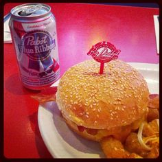 A brilliant combination from a recent Big Daddy's diner! Burger, tots and a @Pabst Blue Ribbon
