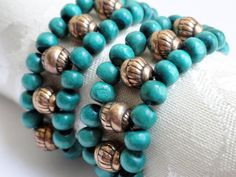 Teal wood beaded napkin rings x 4 woven with by handmadeintoronto, $22.00