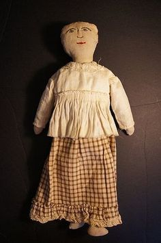 An old soul embroidered face rag doll from the late 1800's