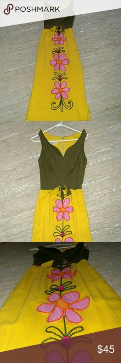 Vintage flower power dress Vintage lovers, check this out. AMAZING vintage embroidered dress. Pink  embroidered flowers down the skirt of the dress with an olive green top. Classic 70's mustard yellow. Waist is 11 inches across, so it is very small. Perfect for tall slender girls. 53 inches in length. Dresses