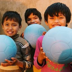 PHOTO OF THE DAY: Nepal: girls at our Kathmandu orphanage home were happy to receive new play equipment today, including these virtually indestructible soccer balls from One World Futbol. The two girls on the left were just recently rescued from child labor and adopted into our home. Full Story: http://peacegospel.org/new-play-equipment-delivered-to-nepal-orphanage-more-girls-rescued/ Raise Awareness: please like & repin!