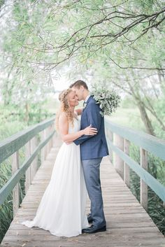 bride and groom picture ideas   northern Michigan wedding   backyard wedding   wedding photography ideas   groom with plaid suit   couple posing ideas   authentic posing   blue and navy wedding   lake michigan wedding   iowa wedding photographer #weddingphotography