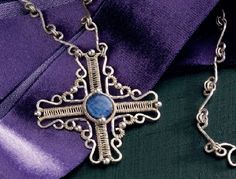 wire jewelry cross pendant by Jodi Bombardier  - from Artisan Filigree: 6 Tips for Transforming Wire into Pretty Wire Jewelry Art