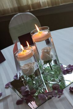 Floating candles with submerged roses are so simple and elegant!