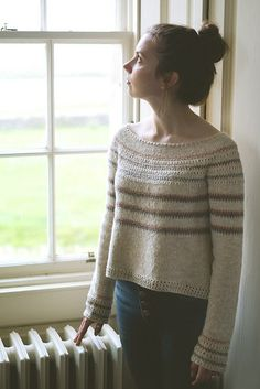 This sweater is worked in one piece from the top down with a circular yoke. Sleeves and body are separated at the underarm. Short rows are used to shape the lower body. Gauge: 26 sts and 36 rows= 4 in