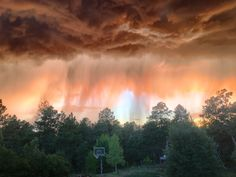 Caption: Sunset behind an approaching thunderstorm