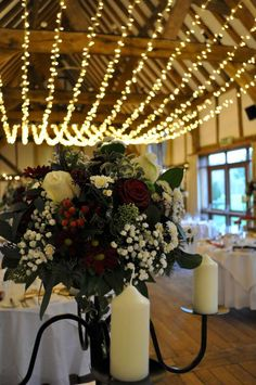 Warm white fairy light canopy in a huge single swag over the dining room