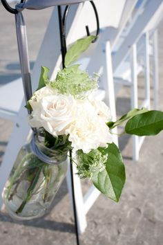 Beach Ceremony Aisle Decor with cream flowers and champagne ribbon. http://www.coastalchicevents.com/ Joanne Klein