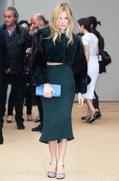 Sienna Miller in a teal furry crop jacket and high-waist matching skirt
