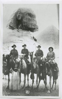 Australian soldiers during the first World War 1918 with Sergeant C.B. Lewis, Private G.W. Hart, Private Howard N. Kimber, Sergeant F.C. McArtney on leave in Egypt, with the Sphinx and one of the pyramids behind them.