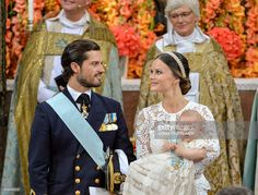 Prince Carl Philip (L) and Princess Sofia with Prince Alexander are pictured at…