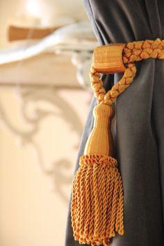 Gray velvet curtains and gold French tassles.