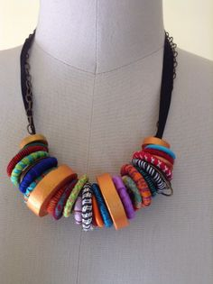 DOL Santa Barbara and neck bling. It's a mix of covered plastic curtain rings, painted wooden beads made of dowels and painted plastic rings. I covered the rings with ribbon, vintage kimono cloth and yarn. Felt Necklace, Fabric Necklace, Diy Necklace, Necklace Ideas, Jewelry Crafts, Jewelry Art, Beaded Jewelry, Jewelry Design, Unique Jewelry