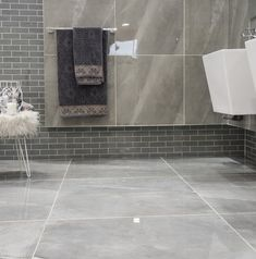 Glossy and polished porcelain tiles don't need fancy patterns and layouts, the gleaming shine is statement enough. Polished Porcelain Tiles, Tile Floor, Layouts, Fancy, Patterns, Luxury, Home Decor, Block Prints, Decoration Home
