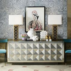 The Jonathan Adler Talitha Credenza is made out of wood that is covered entirely in Antique Silver-finish nickel-plated metal. This entire surface is stamped by hand to create one-of-the-kind texture. The geometric studded pattern on the doors gives the piece an edgy, rock and roll sensibility.