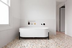 The bathroom features terrazzo floor tiles—which have a similar pattern to the material used to construct the fireplace in the living room. Tagged: Bath Room, Freestanding Tub, Terrazzo Floor, and Subway Tile Wall. London Townhouse, London House, Funky Bathroom, Modern Bathroom, Bathroom Ideas, Master Bathroom, Beach Bathrooms, Bathroom Inspo, Bathroom Interior
